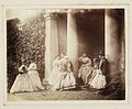 Calvert Richard Jones (on the right), with six women, a man, boy, girl and dog, standing and sitting in a colonaded porchway. (4094885775).jpg