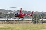 Canberra Helicopters (VH-FOA) Robinson R44 operating joy flights at the 2018 Canberra Airport open day.jpg