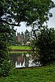 Capesthorne Hall through a gap in the trees-7544675592.jpg