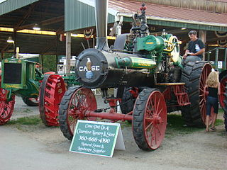 Steam tractor vehicle powered by a steam engine which is used for pulling