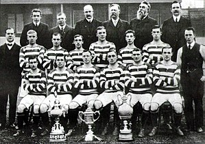 Alec McNair - 1908 Celtic team photo with the League Championship, Scottish Cup and Glasgow Cup trophies; McNair is bottom  row, far right