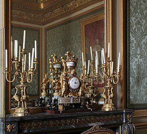 Garniture - A garniture of an ormolu clock and candelabra