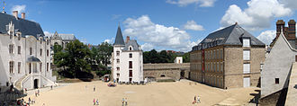 Château des ducs de Bretagne - The courtyard of the château, from left to right; le Grand Gouvernement, which served as the residence of the governors of Brittany, otherwise known as le Palais Ducal; La Conciergerie, currently Caretaker's Lodge, but housed first the lieutenant of the duke, then the castle's arsenal of weapons; Le Harnachement, also used to store artillery, now an exhibition centre; Le Petit Gouvernement, the former home of the king of France on his visits to Nantes; and to the side, Les Murailles Extérieures, the walls of the castle. In the left background lies the Cathedral of St. Peter and St. Paul