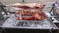 Файл:Charcoal Rosted Pork Whole Pig.ogv