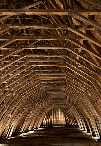 Oak - Heart of oak beams of the frame of Saint-Girons church in Monein, France