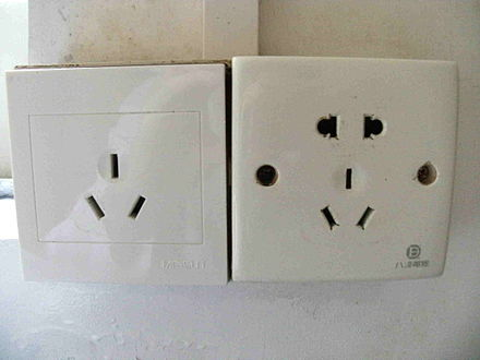 Chinese 3-pin socket and compound socket which also accepts NEMA and Europlug (right), and a less common, larger 16 A version (left) China's 3-pin sockets.jpg