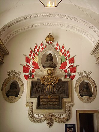 Monarchy of Denmark - Memorial inside Christiansborg Palace. Depicted is Frederick III and the event commemorated is the failed Swedish attack on Copenhagen in 1659.