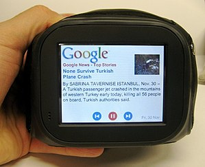 Chumby - A Chumby being held and displaying a Google News story