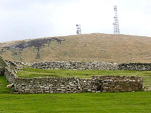 Clumlie Broch - Clumlie Broch, behind a field wall