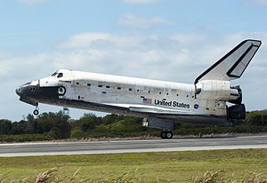 Concluding the STS-133 mission, Space Shuttle Discovery touches down at the Shuttle Landing Facility - cropped.jpg