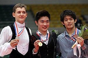Maxim Kovtun - Kovtun at the 2013 Cup of China podium.
