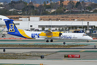 Alaska Nanooks - A Dash 8-Q400 of Horizon Air was painted to advertise the Alaska Nanooks. The aircraft is seen here at Los Angeles International Airport (February 2014)