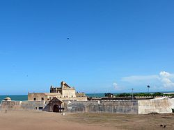 A view of Dansborg Fort with Bay of Bengal in the background