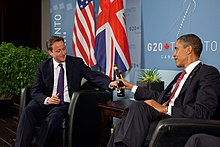 US President Barack Obama and British Prime Minister David Cameron trade bottles of beer to settle a bet they made on the U.S. vs. England World Cup Soccer game (which ended in a tie), during a bilateral meeting at the G20 Summit in Toronto, Canada, Saturday, 26 iunie 2010