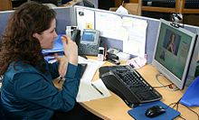 Deaf or HoH person at her workplace using a Video Relay Service to communicate with a hearing person via a video interpreter and sign language IMG 2954.jpg