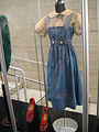 "Debbie Reynolds Auction - 016 - Judy Garland ""Dorothy Gale"" Arabian-pattern test ""Ruby Slippers"" and dress with blouse from ""The Wizard of Oz"".jpg"