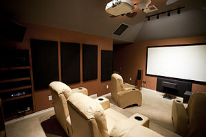 Home cinema - A dedicated home theater room with acoustic treatment, professional wiring, equipment and speaker placing