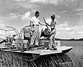 Deer poacher in Everglades National Park being checked by ranger in air boat. (bcbb893ffed2413b8a423708c687b2cb).jpg