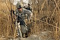 Defense.gov News Photo 110131-A-9563P-045 - U.S. Army Spc. Nicholas Francioso crosses a small irrigation canal during a patrol in the Arghandab district in Afghanistan s Kandahar province on.jpg
