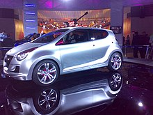 A view of a white coloured car put for show at Auto expo