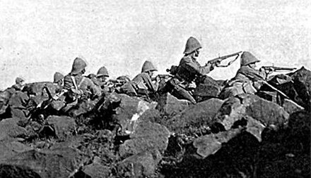 Soldiers of the Devonshire Regiment at the Relief of Ladysmith, 1900. They are facing Pepworth Hill, firing from behind boulders which provided for an effective cover. Devonshire Regiment-Ladysmith.JPG