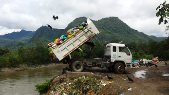 Dump Truck Dumping Toxic Medical Waste.png