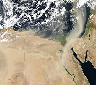 Geography of Egypt - A large plume of Saharan Desert dust (light brownish pixels) blown across Libya and Egypt northward over the Mediterranean Sea toward the Middle East, on February 2, 2003.