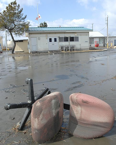 A solemn desk chair lies in a layer of mud and petroleum that now covers much of the U.S. FISC Yokosuka Defense Fuel Support Point Hachinohe facility following the tsunami. Image: DVIDSHUB.