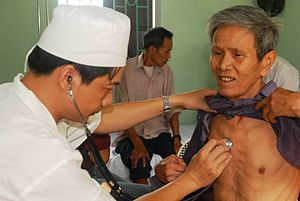 Elderly vietnamese man gets examined.jpg