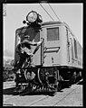 Engine driver entering ED loco through front door. PHOTOGRAPHER J.F. Le Cren DATE 1953.jpg