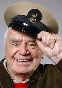 Ernest Borgnine shows off his new Chief Petty Officer cover