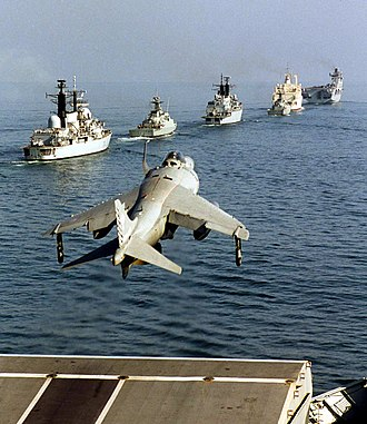 STOVL - A Sea Harrier launches from the flight deck of HMS Illustrious in 2001