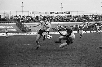 Hans van Breukelen - Hans van Breukelen attempting to stop a shot by Theo de Jong in 1979.