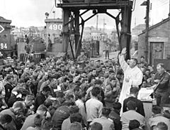 Military Catholic chaplain Father (Major) Waters conducts Divine Services, June 1944