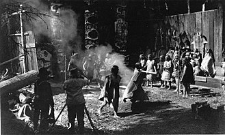 In the Land of the Head Hunters - George Hunt (with megaphone), Edward S. Curtis, and actors filming In The Land of the Head Hunters