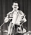 Flaco Jimenez (musician) on stage at Farnham, U.K., 1985.jpg