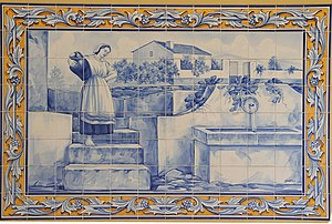 Mira, Portugal - Azulejo showing a maiden collecting water from the fountain of São Bento