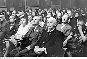 Cultural Association of the GDR - Celebration of the association's first birthday in 1946.  Prominent in the front row are the painter Max Pechstein (left) and Berlin's first post-war mayor, Arthur Werner (right).