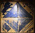 Fragment del paviment gòtic del segle XV amb els emblemes del gremi de Velluters, col·legi de la Seda, València.JPG