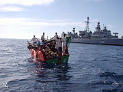 """German frigate """"Karlsruhe"""" rescuing shipwrecked people off the coast of Somalia while participating in the international anti-terror operation ENDURING FREEDOM, April 2005"""