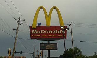 McDonaldland - A blue Fry Kid is seen sitting on a McDonald's sign in Milwaukee, Wisconsin.