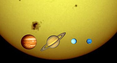 The four gas giants against the Sun: Jupiter, Saturn, Uranus, Neptune (Sizes to scale)