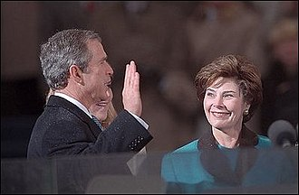 First inauguration of George W. Bush - George W. Bush takes the oath of office as the President of the United States.