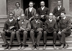 George Washington Carver - George Washington Carver (front row, center) poses with fellow faculty of Tuskegee Institute in this c. 1902 photograph taken by Frances Benjamin Johnston.