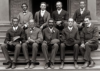 Tuskegee University -  George Washington Carver (front row, center) poses with fellow faculty of Tuskegee Institute in this c. 1902 photograph taken by Frances Benjamin Johnston.