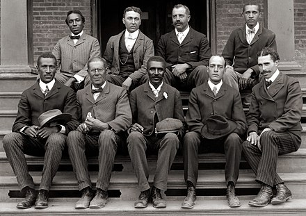 George Washington Carver (front row, center) poses with fellow faculty of Tuskegee Institute in this c. 1902 photograph taken by Frances Benjamin Johnston. George Washington Carver, ca. 1902.jpg