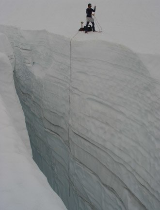 Glacier mass balance - Measuring snowpack in a crevasse on the Easton Glacier, North Cascades, USA, the two dimensional nature of the annual layers is apparent