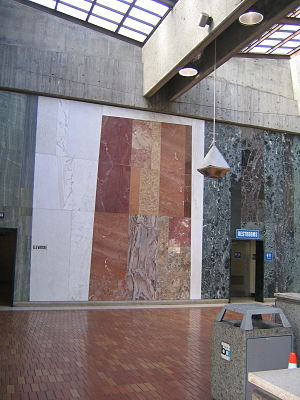Ernest Born - Glen Park BART Station, with natural light on the concourse and an abstract mural in marbles.