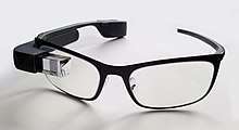 28a97775f19f A Google Glass with black frame for prescription lens.