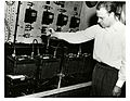 Herbert J. Reed of the Electrochemistry Section measuring specific gravity on a battery.jpg